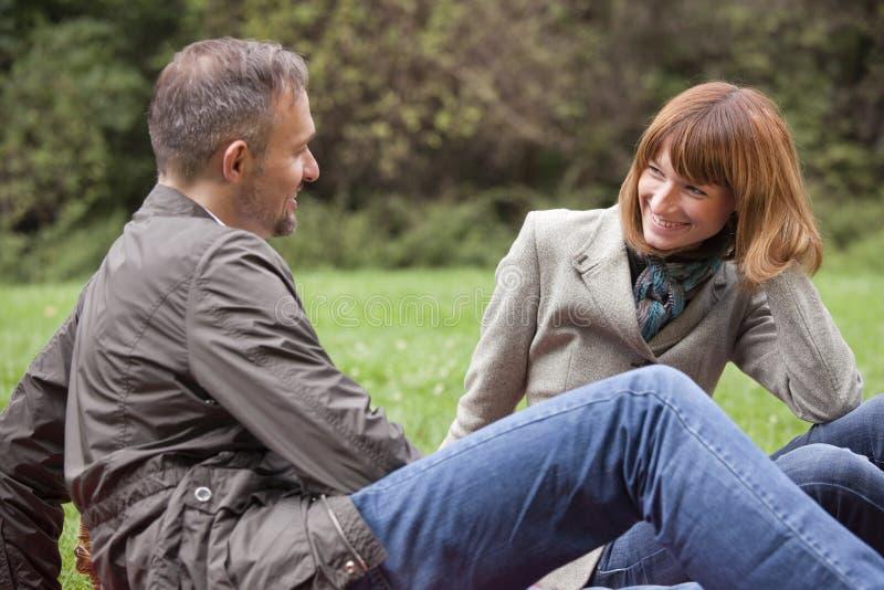 Romantic couple. Flirting in a city park stock photos