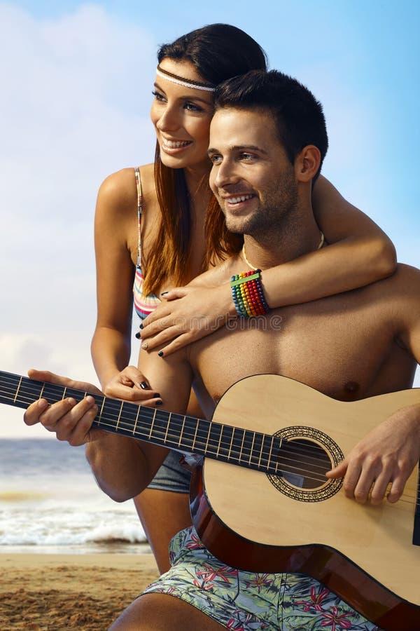 Romantic couple on the beach stock photo