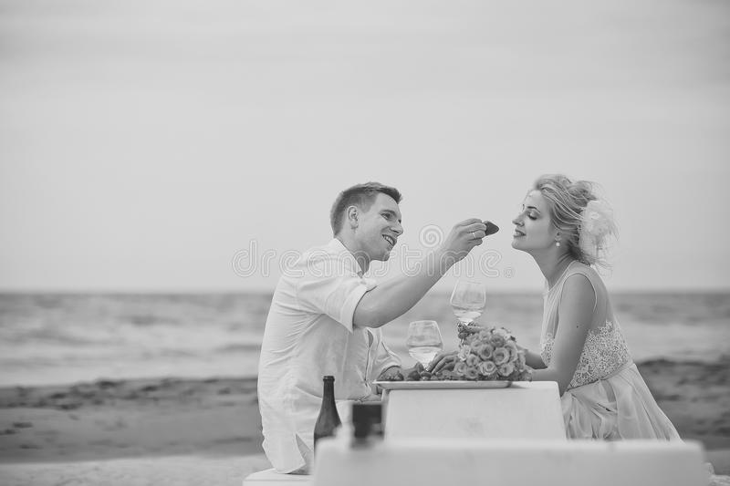 Romantic couple. Wedding couple eating on beach royalty free stock photography