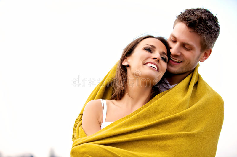 Romantic Couple With Blanket Laughing Stock Image