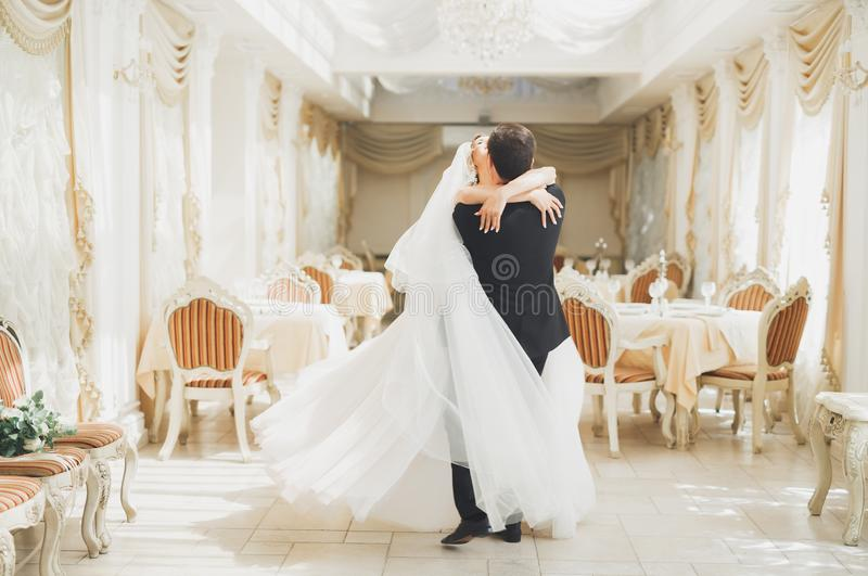 Romantic couple dancing and kissing on their wedding stock image