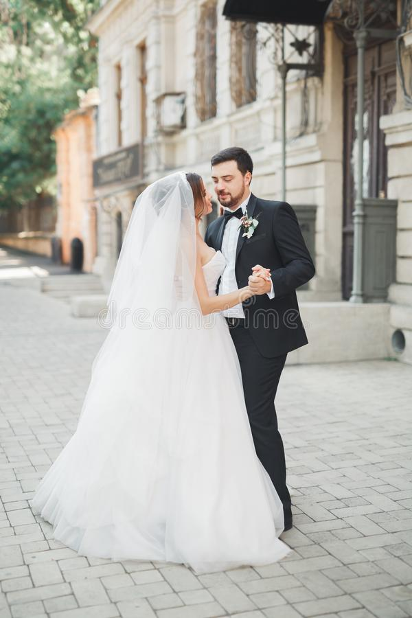 Romantic couple dancing and kissing on their wedding stock photo