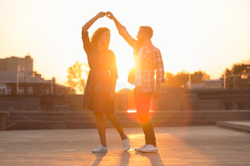 Romantic couple dancing and spending time together in city royalty free stock photo
