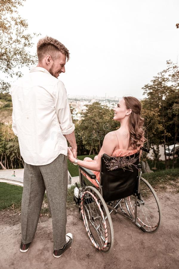 Romantic couple of disabled girl and young man looking happy and smiling royalty free stock images