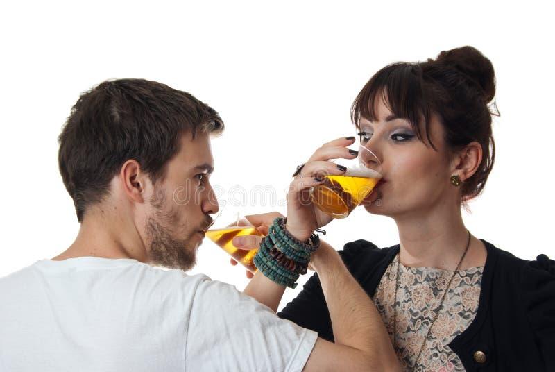 Romantic couple drinking beer stock photo