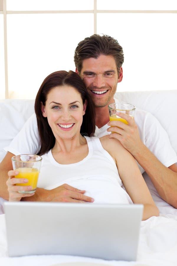 Romantic couple drinking orange juice
