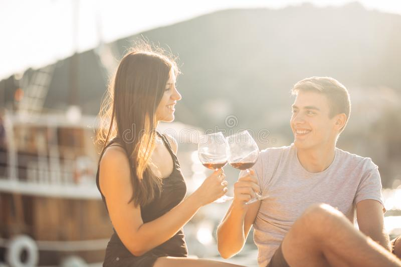 Romantic couple drinking wine at sunset.Romance.Two people having a romantic evening with a glass of wine near the sea.Cruise ship. Vacation.Luxury class royalty free stock images