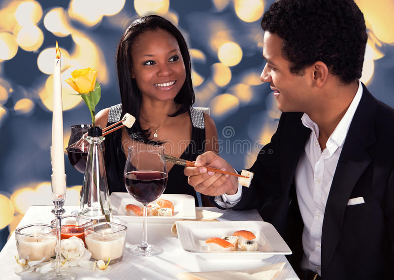 Download Romantic Couple Eating Sushi Stock Photo - Image: 30507636