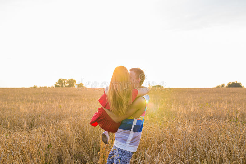 Romantic couple embraces in the field. Romantic young couple embraces in the field stock photo