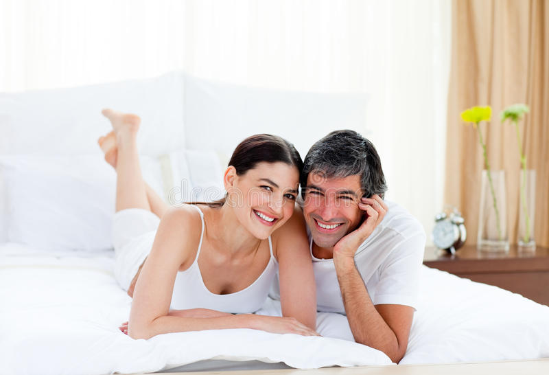 Download Romantic Couple Embracing Lying On Their Bed Stock Image - Image: 13154427