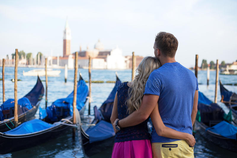 Romantic couple enjoying evening in Venice royalty free stock photo