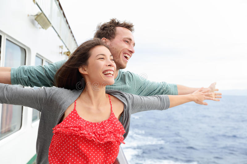 Romantic couple fun in funny pose on cruise ship. Romantic couple having fun laughing in funny pose on cruise ship boat. Smiling happy men and women on travel stock photography