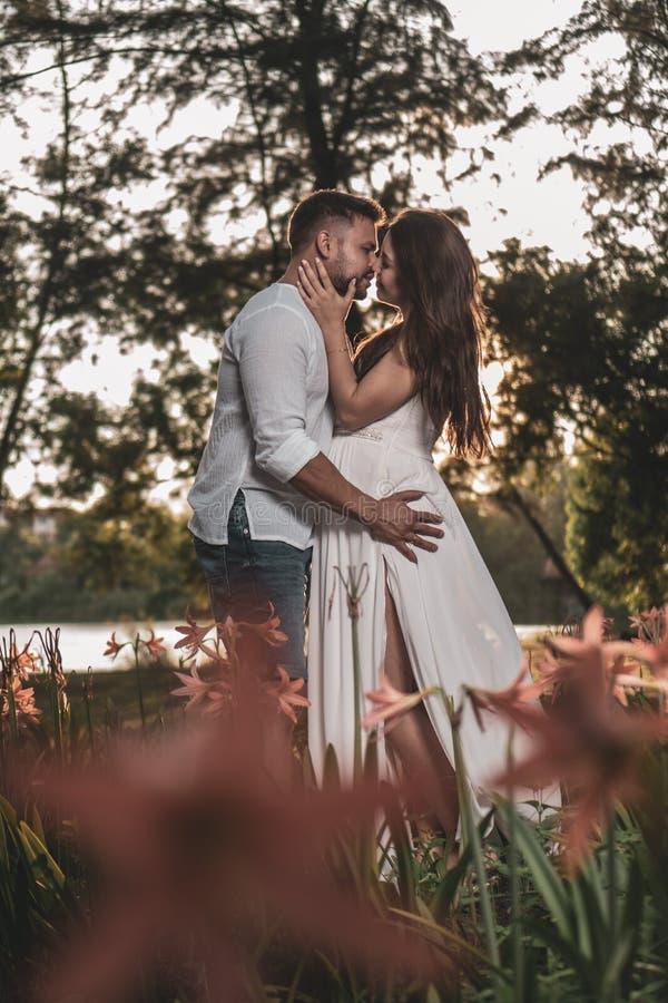 Romantic couple in the garden royalty free stock photo