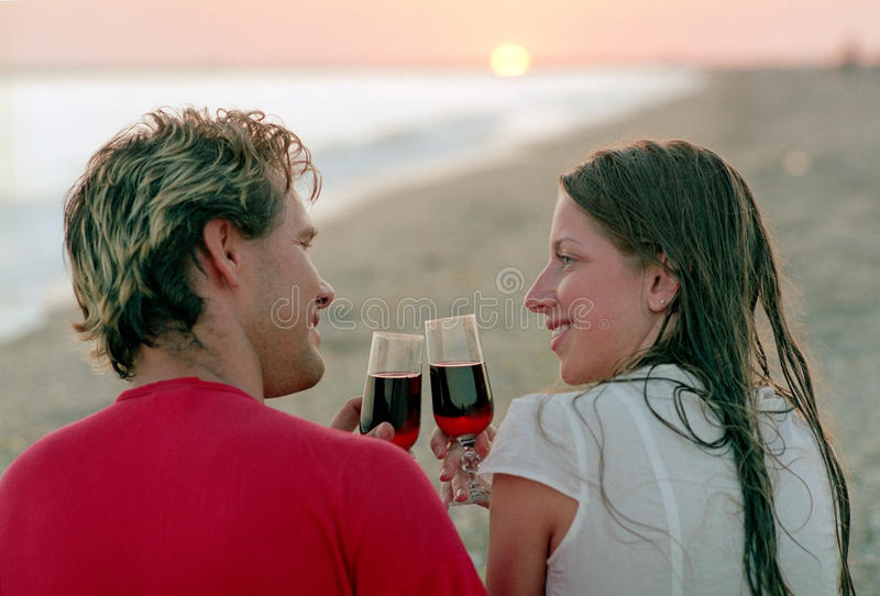 Download Romantic Couple With Goblet Of Wine On A Beach Stock Photo - Image: 10206910