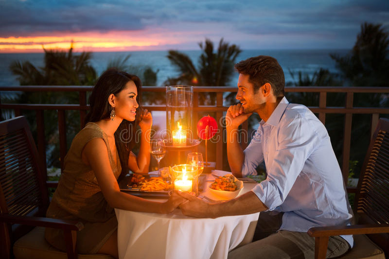 Romantic couple have dinner outdoor. Romantic couple have dinner with sunset and candlelight outdoor, concept love, relationship and romantic royalty free stock photos