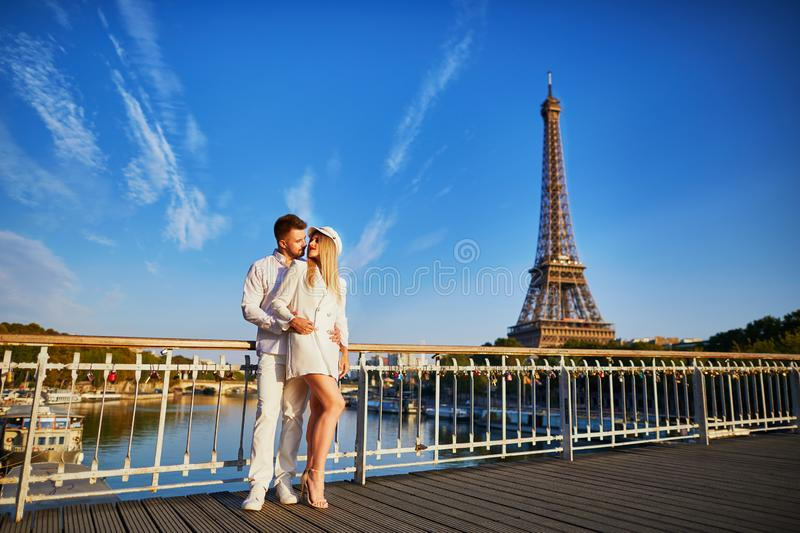 Romantic couple having a date near the Eiffel tower. Tourists in Paris enjoying the city royalty free stock images