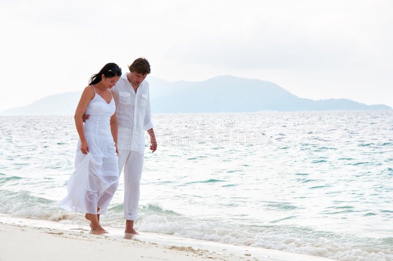 Romantic couple having a walking on the sea sho. Picture of romantic young couple having a walking on the sea shore stock photography