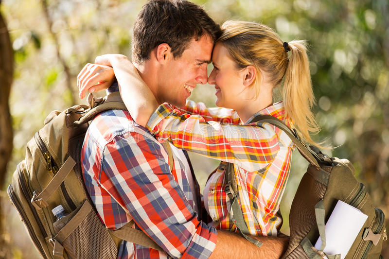 Romantic couple hiking stock photo