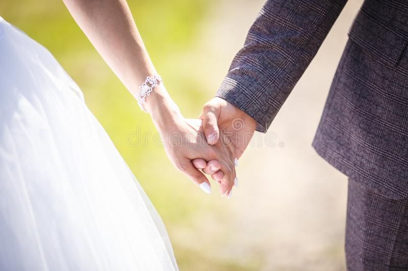 Romantic couple holding hands. Lovers or newlywed married young couple in romance. wedding theme.  royalty free stock photography