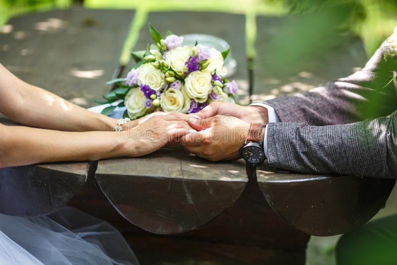 Romantic couple holding hands. Lovers or newlywed married young couple in romance. wedding theme.  stock images