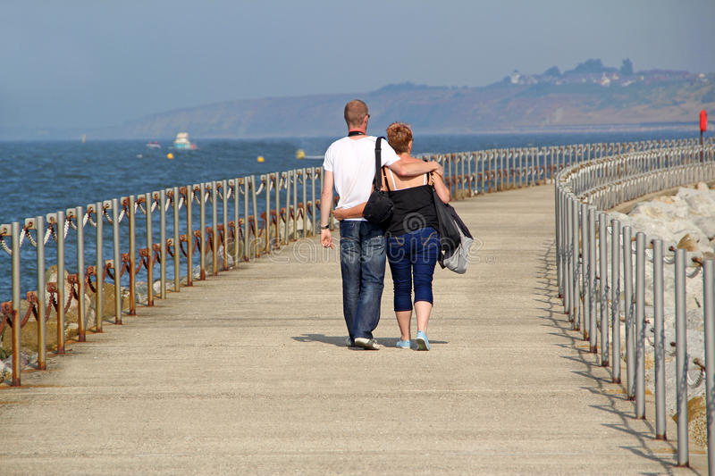 Download Romantic Couple On Holiday Walk Editorial Photography - Image of causeway, coast: 32559047