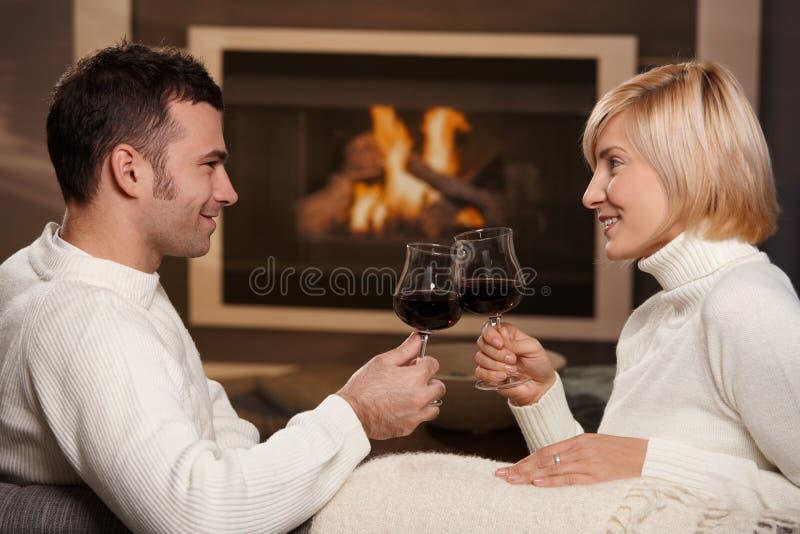 Romantic couple at home stock photos