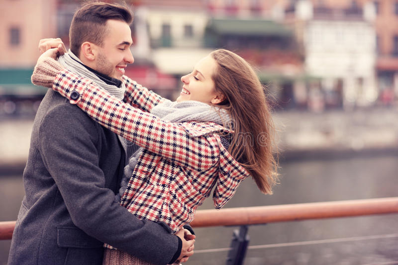 Romantic couple hugging on a date in the city stock images
