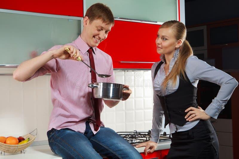 Romantic couple at kitchen royalty free stock photo