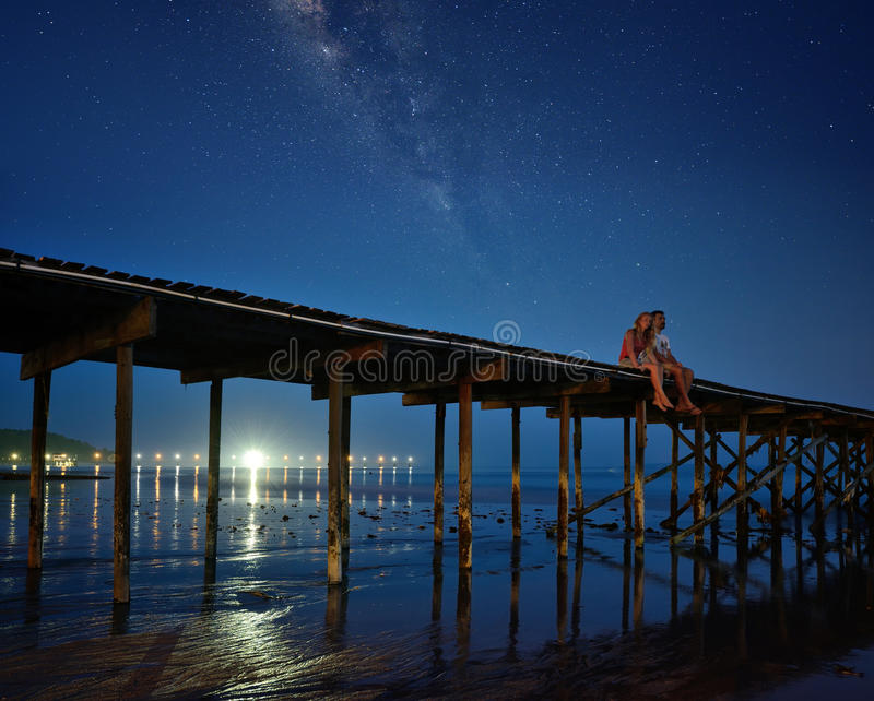 Romantic couple looking at stars stock photography