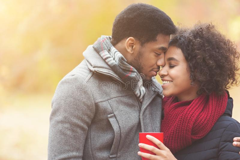 Romantic couple in love dating in park at autumn stock photography