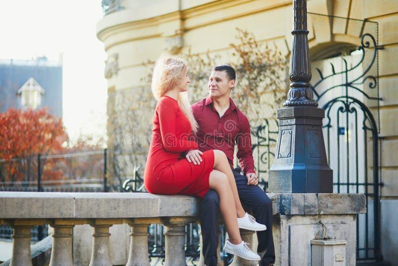 Romantic couple kising on a Parisian street stock photos