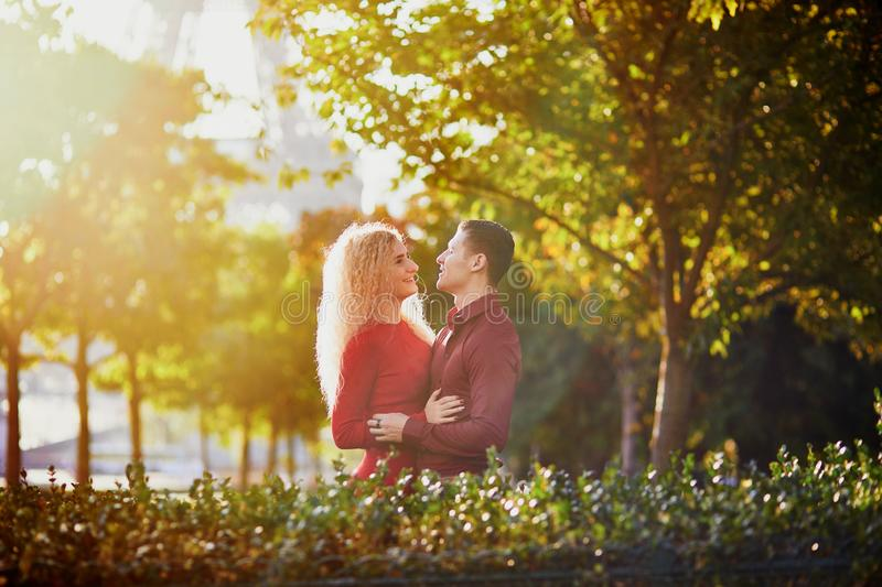Romantic couple in love near the Eiffel tower stock image