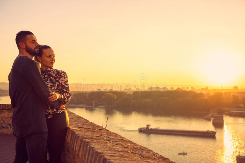 Romantic couple in love at  sunset stock photography
