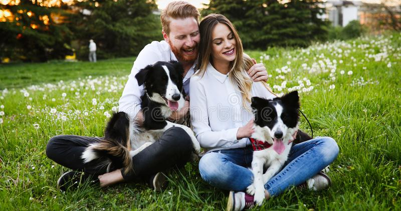 Romantic couple in love walking dogs and bonding stock images