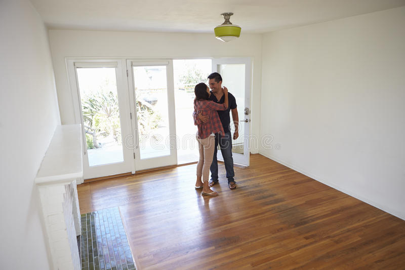 Romantic Couple In New Home On Moving Day royalty free stock photography