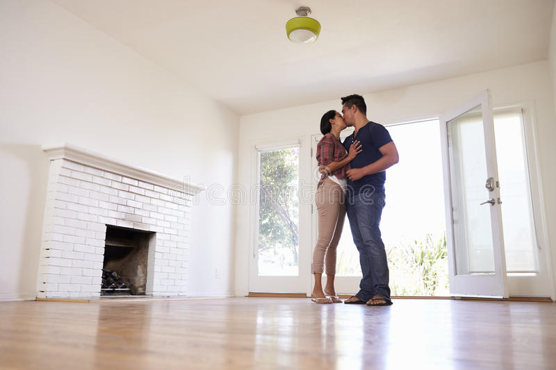 Romantic Couple In New Home On Moving Day royalty free stock photo