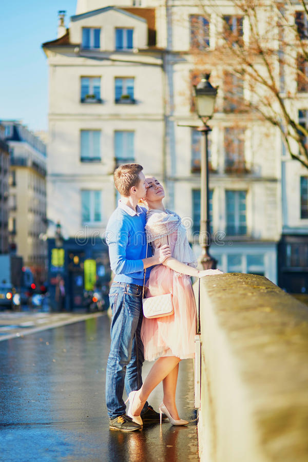 Romantic couple in Paris, France. Young romantic couple on the Seine embankment in Paris, France royalty free stock image