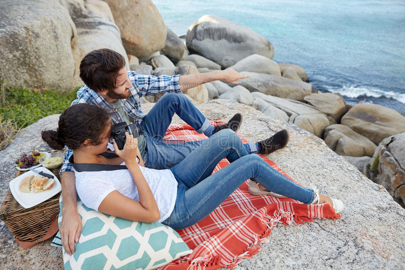 Romantic couple, during a picnic on the rocks royalty free stock photo