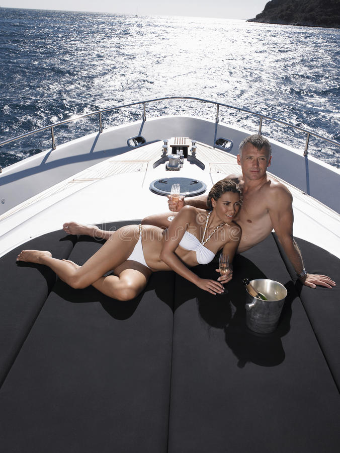 Romantic Couple Relaxing On Yacht stock image
