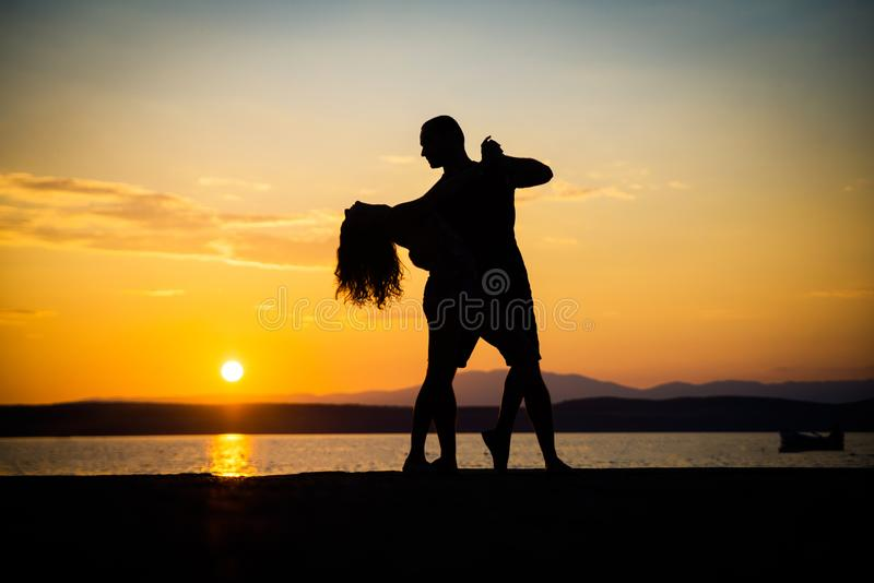 Romantic couple silhouettes royalty free stock photography