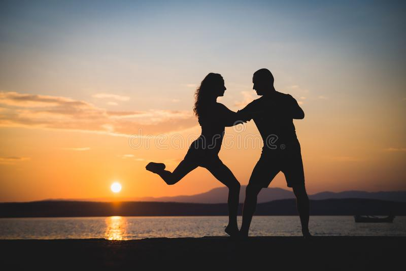Romantic couple silhouettes royalty free stock photos