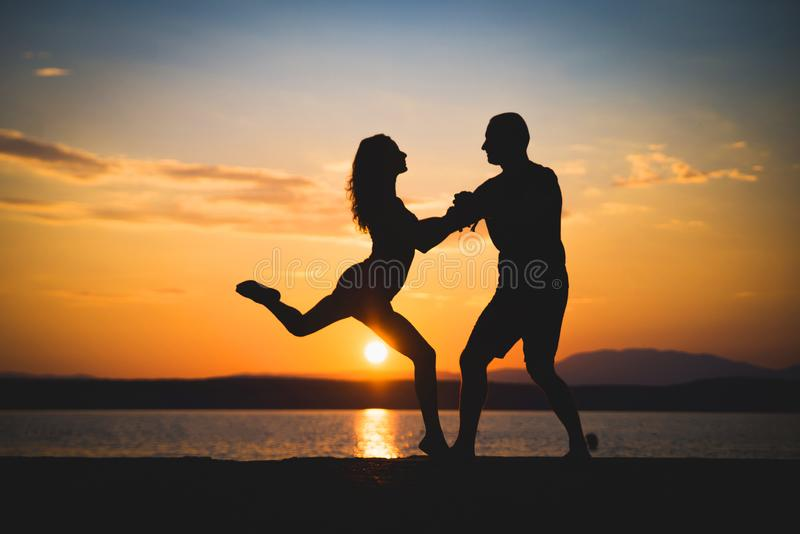 Romantic couple silhouettes stock images