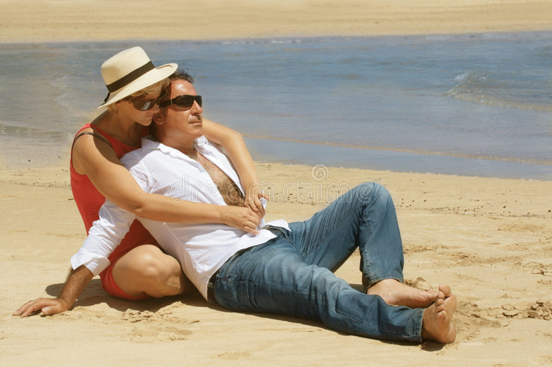 Romantic couple sitting on the stock photography