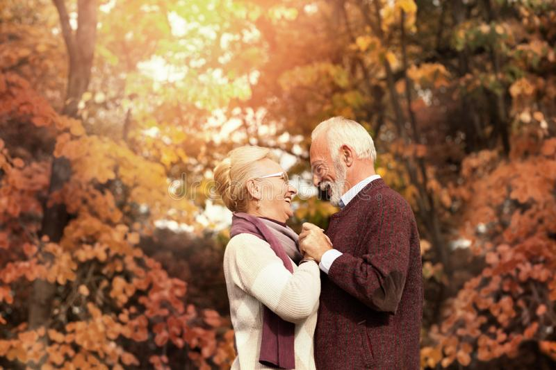Romantic couple smiling and dancing on a sunny day royalty free stock photography