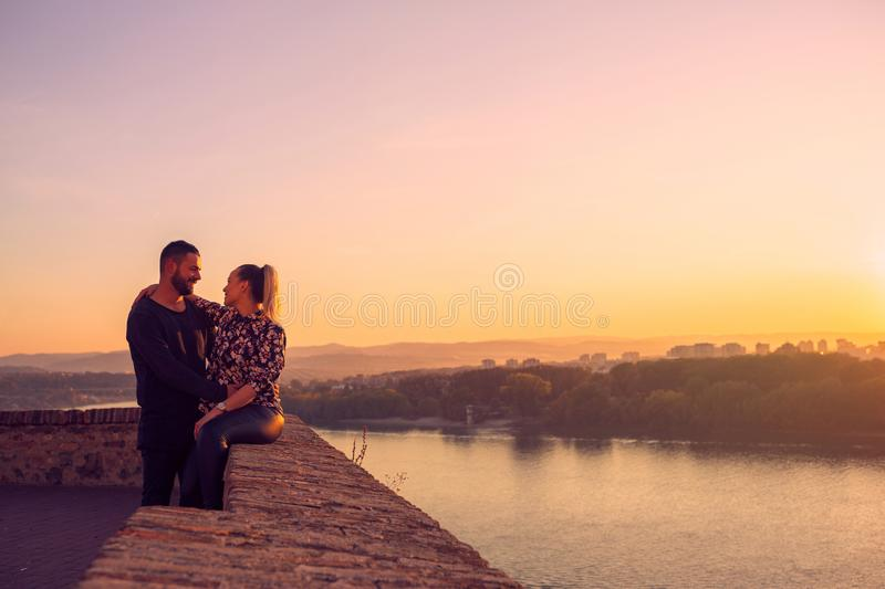 Romantic couple spend time together at sunset royalty free stock image