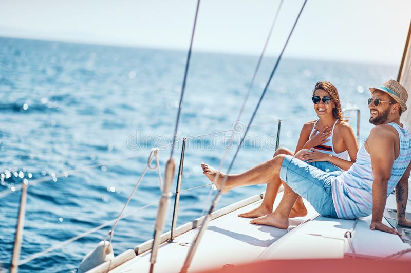 Romantic couple spending time together and relaxing on yacht stock photography