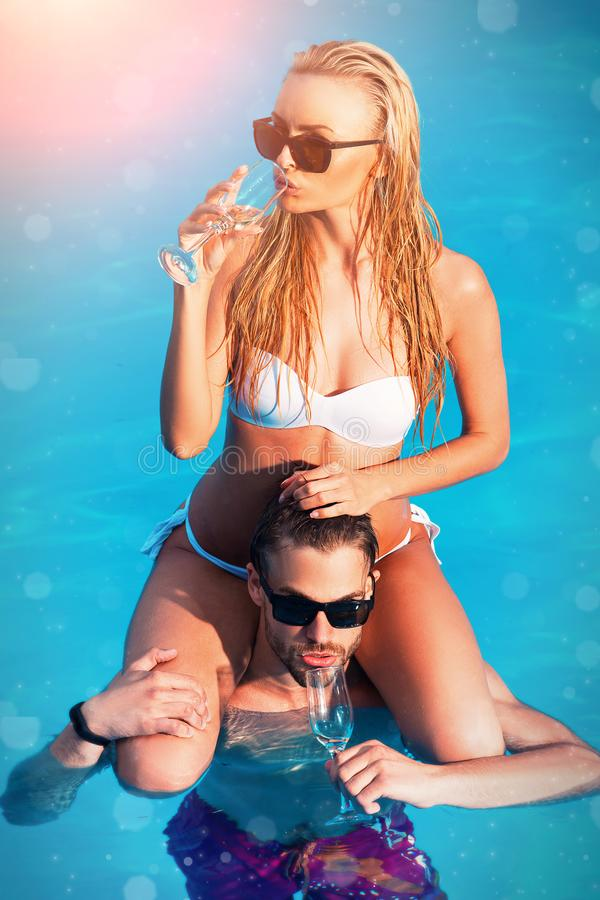 Romantic couple. Summer vacation and travel to ocean. Maldives or Miami beach water. Sexy couple relaxing in resort stock photo