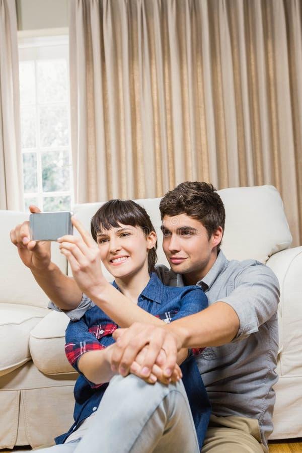 Romantic couple taking selfie royalty free stock photo