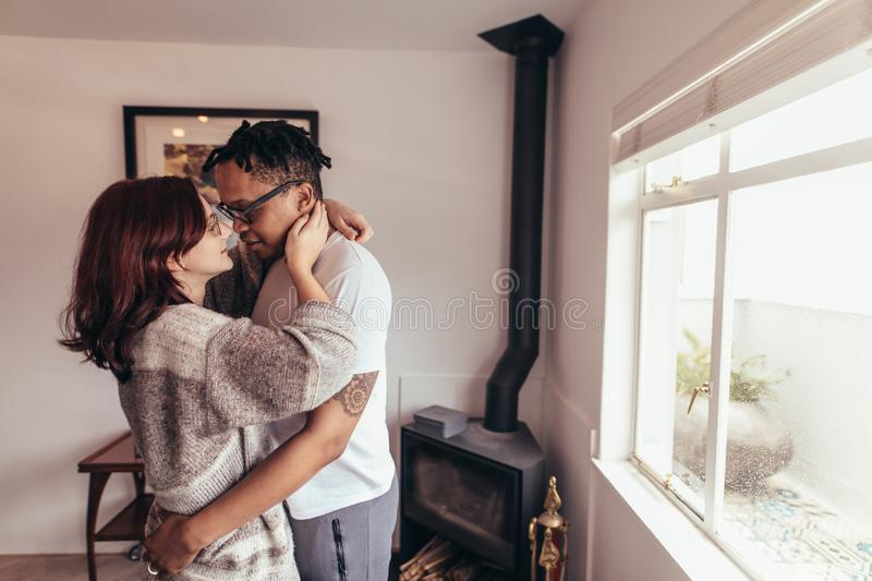Romantic couple together at home stock images