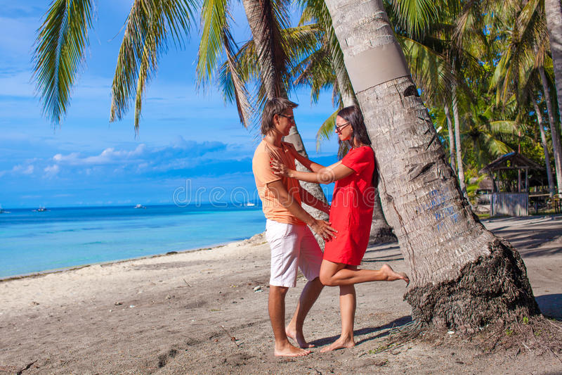 Romantic Couple At Tropical Beach Near Palm Tree Royalty Free Stock Photo